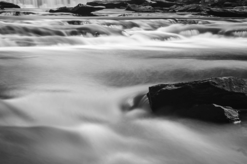 617378218 istock photo soft slow moving creek below a dam 451665557