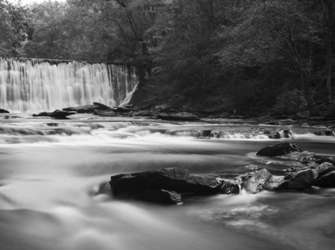617378218 istock photo soft slow moving creek below a dam 451665675
