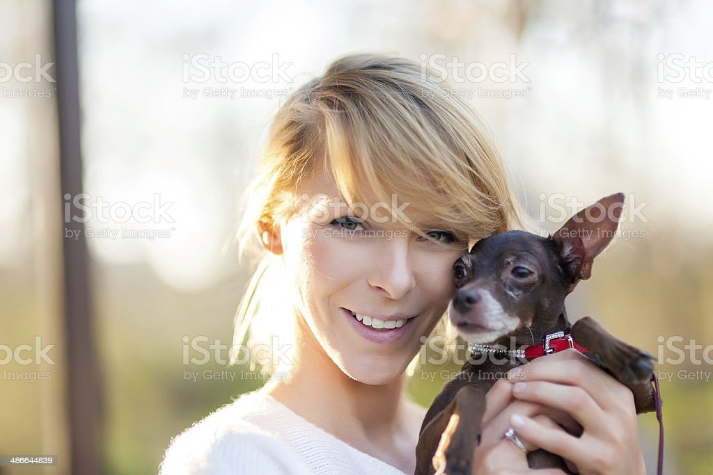 Soft spring portrait of young woman and little doggy royalty-free stock photo