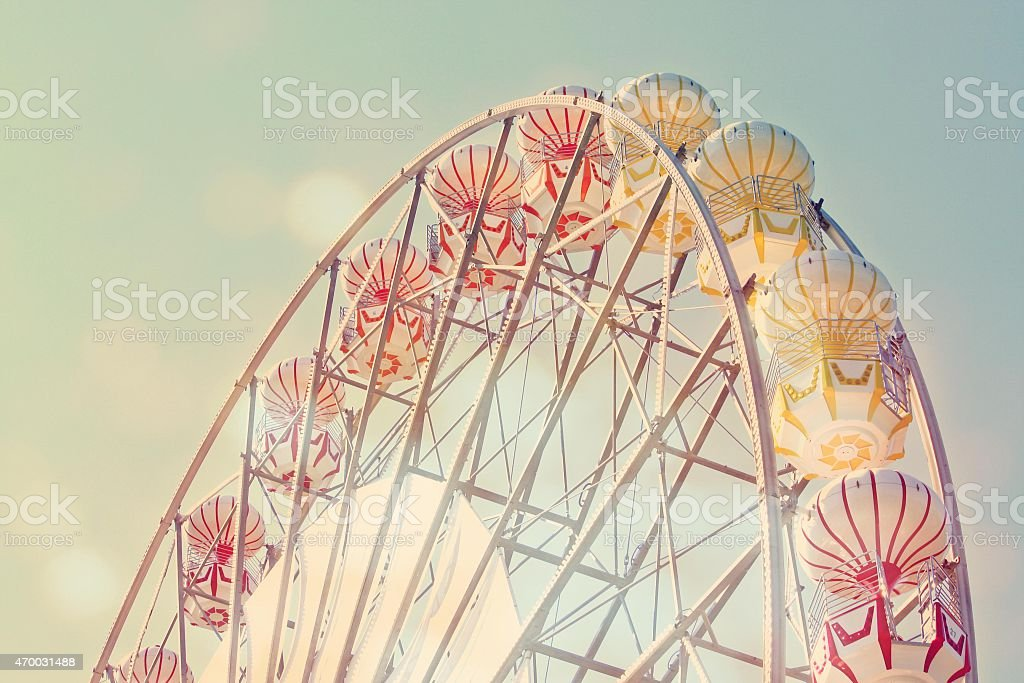 Soft tone colored close-up of a retro styled Ferris wheel stock photo