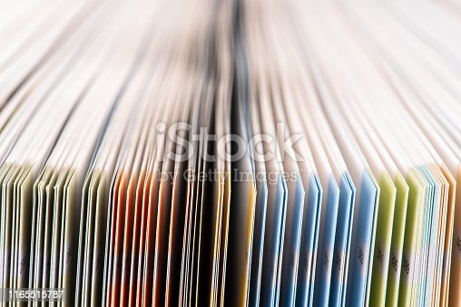 621728016istockphoto Soft toned colorful opened book pages 1165515787