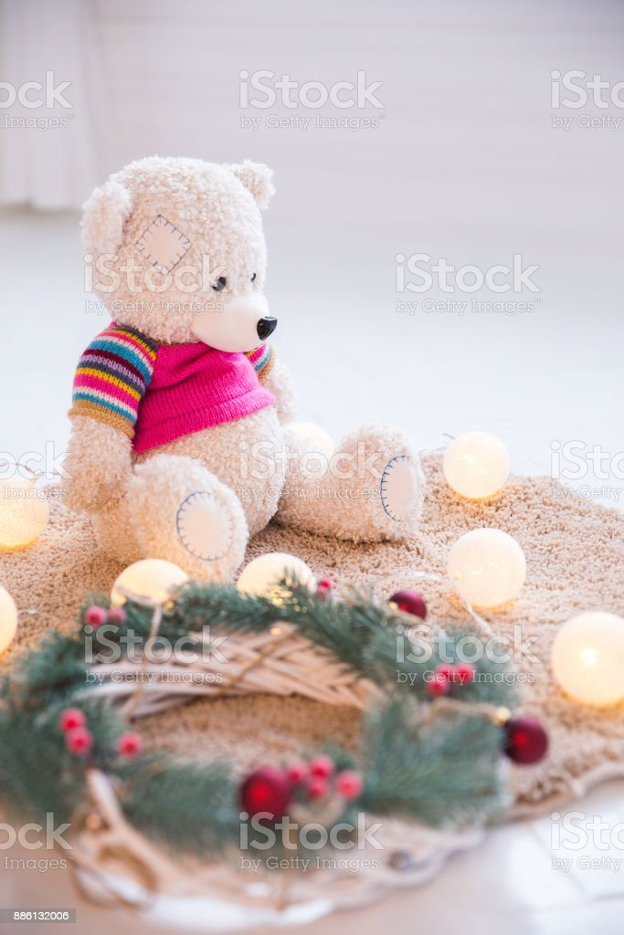 Soft toy and a Christmas decorative wreath stock photo