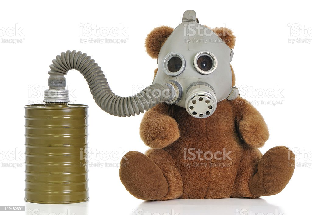 Soft toy bear with gas mask royalty-free stock photo