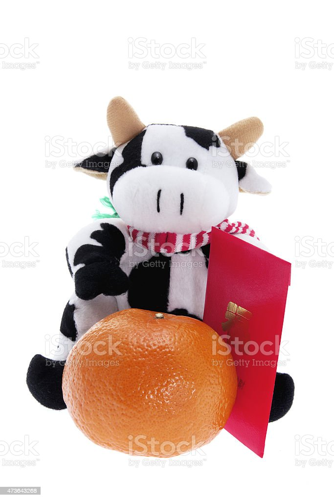 Soft Toy Cow and Mandarin stock photo