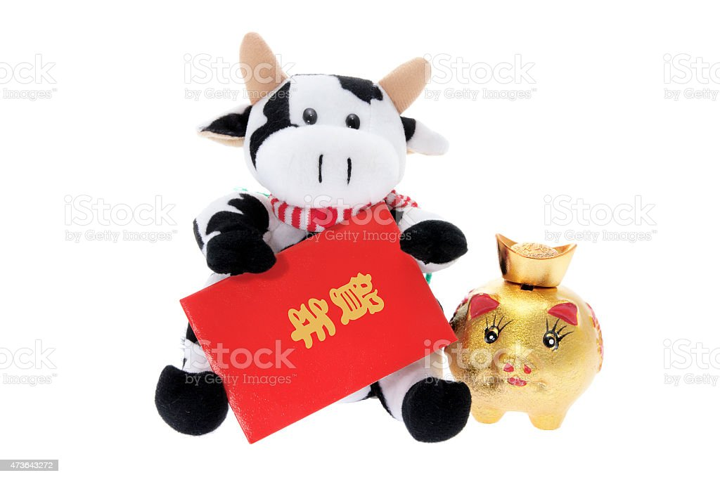 Soft Toy Cow with Chinese New Year Decorations stock photo