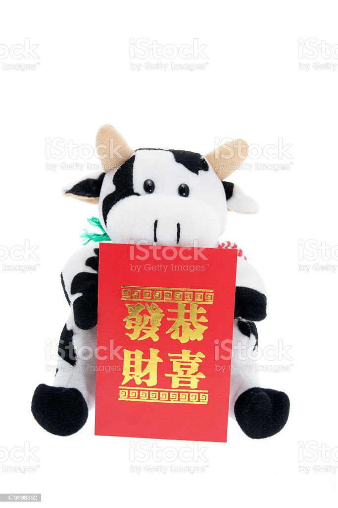 Soft Toy Cow with Lucky Money Envelope stock photo