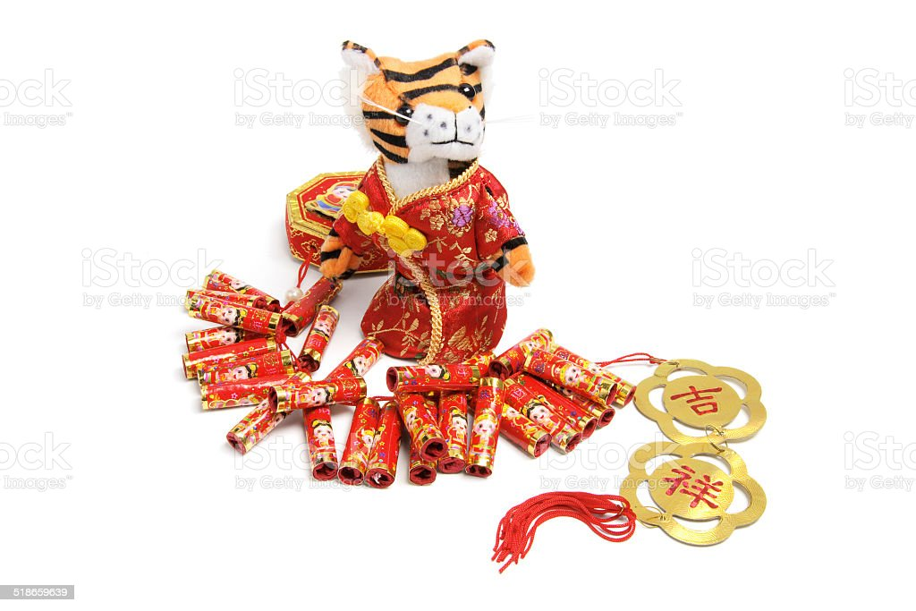 Soft Toy Tiger and Firecrackers stock photo