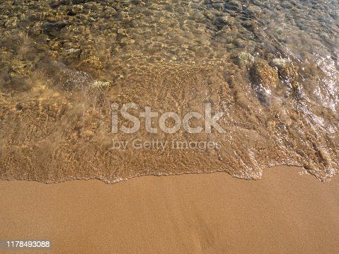 istock Soft wave lapped the sandy beach 1178493088