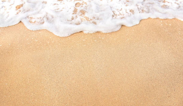 Soft wave lapped the sandy beach stock photo