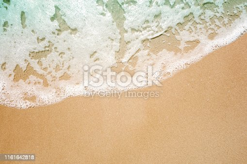 istock Soft wave lapped the sandy beach, Summer Background 1161642818