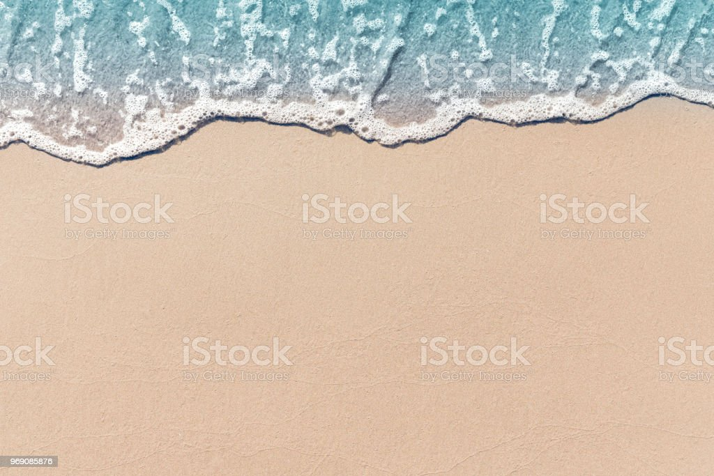 Soft wave lapped the sandy beach, Summer Background. stock photo