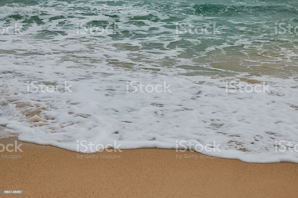Soft wave of blue ocean on sandy beach. Background. royalty-free 스톡 사진