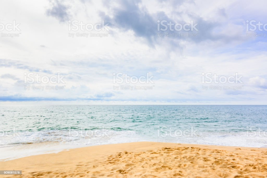 Soft wave of blue ocean on sandy beach for background stock photo