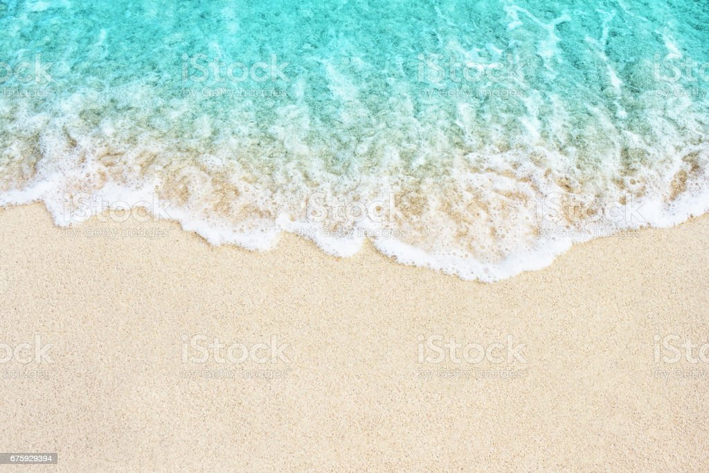 Soft wave of blue ocean on the beach stock photo