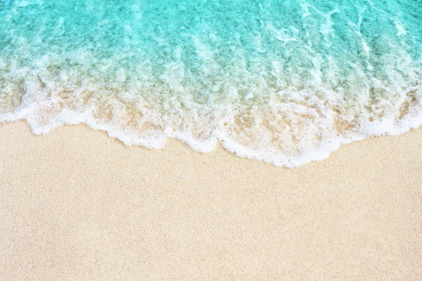 soft wave of blue ocean on the beach - wave stock photos and pictures