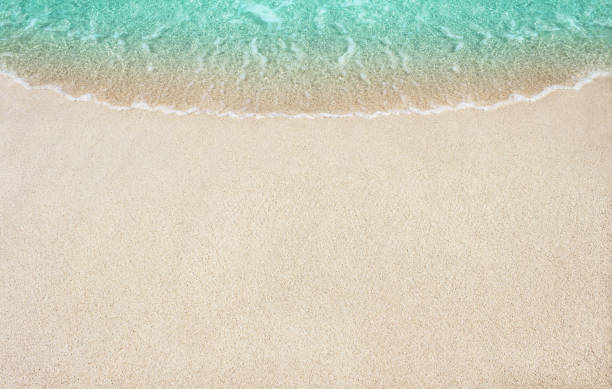 Soft wave of blue ocean the beach stock photo