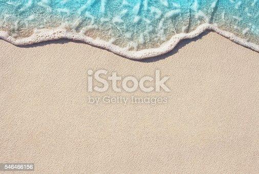 istock Soft wave of ocean on sandy beach 546466156