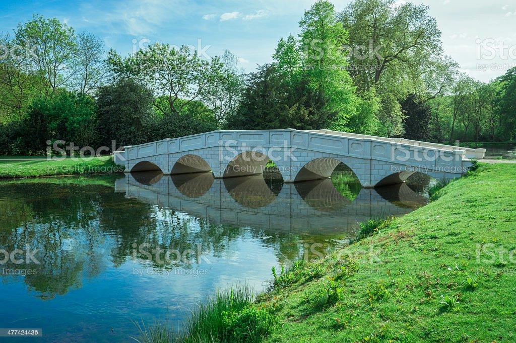 Soft white bridge in lake May stock photo