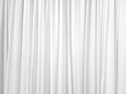 Soft white curtains are simple yet elegant for graphic design or wallpaper. Blurred cloth pattern with luxurious texture. Beautiful abstract background with smooth waves in a vintage style.