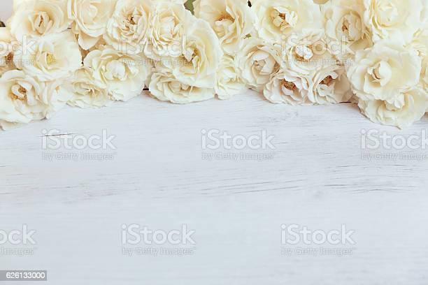 Soft white roses framing wooden background picture id626133000?b=1&k=6&m=626133000&s=612x612&h=i l7guxuce63rklo6k41mfwbyymqkqkrfzdhfypgl e=