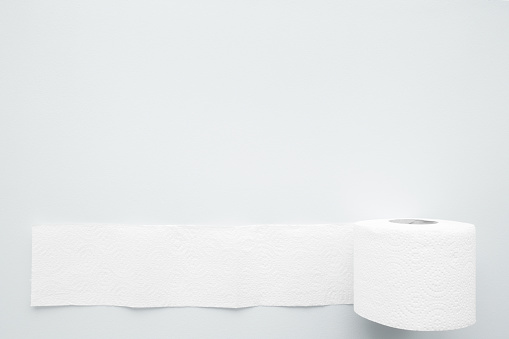 istock Soft, white toilet paper roll on light gray background. Hygiene concept. Empty place for text, object or logo. Top view. Closeup. 1182426191