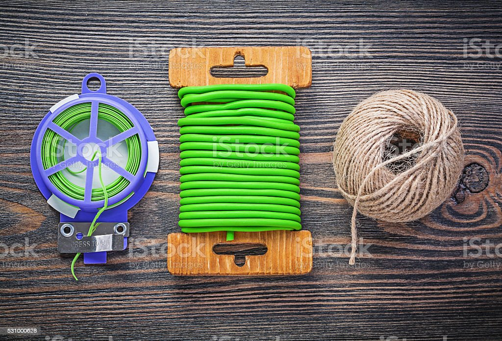 Soft wire tie skein of string on wooden board gardening stock photo