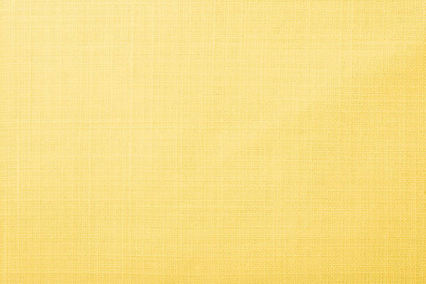 Soft yellow fabric background Soft yellow cloth fabric texture wallpaper background bamboo material stock pictures, royalty-free photos & images