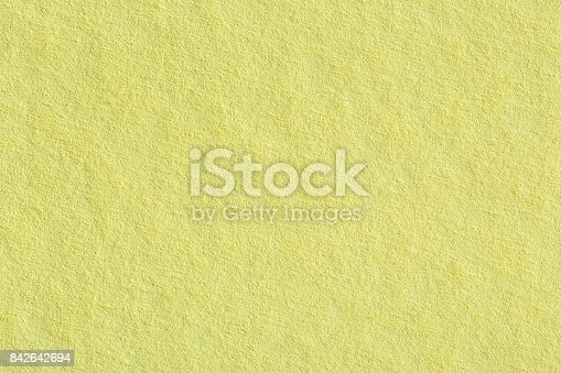 1207526097 istock photo Soft yellow paper texture 842642694