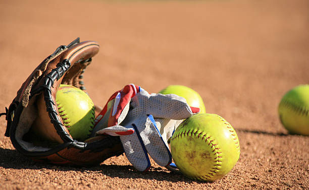 softball baseball balls and batters glove - softball stock photos and pictures