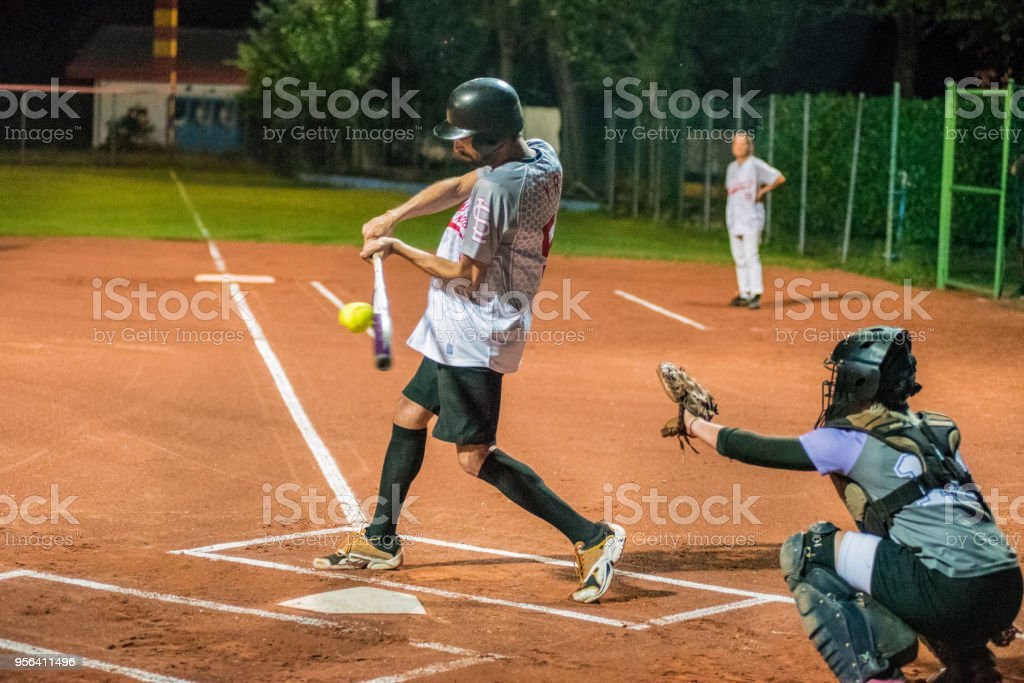 Softball Batter Hitting the Ball stock photo
