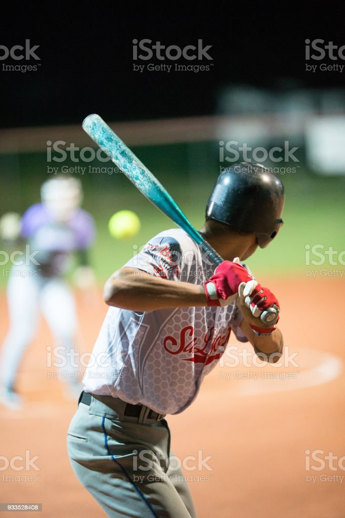 Softball Batter Preparing to Hit the Ball Mid Air stock photo