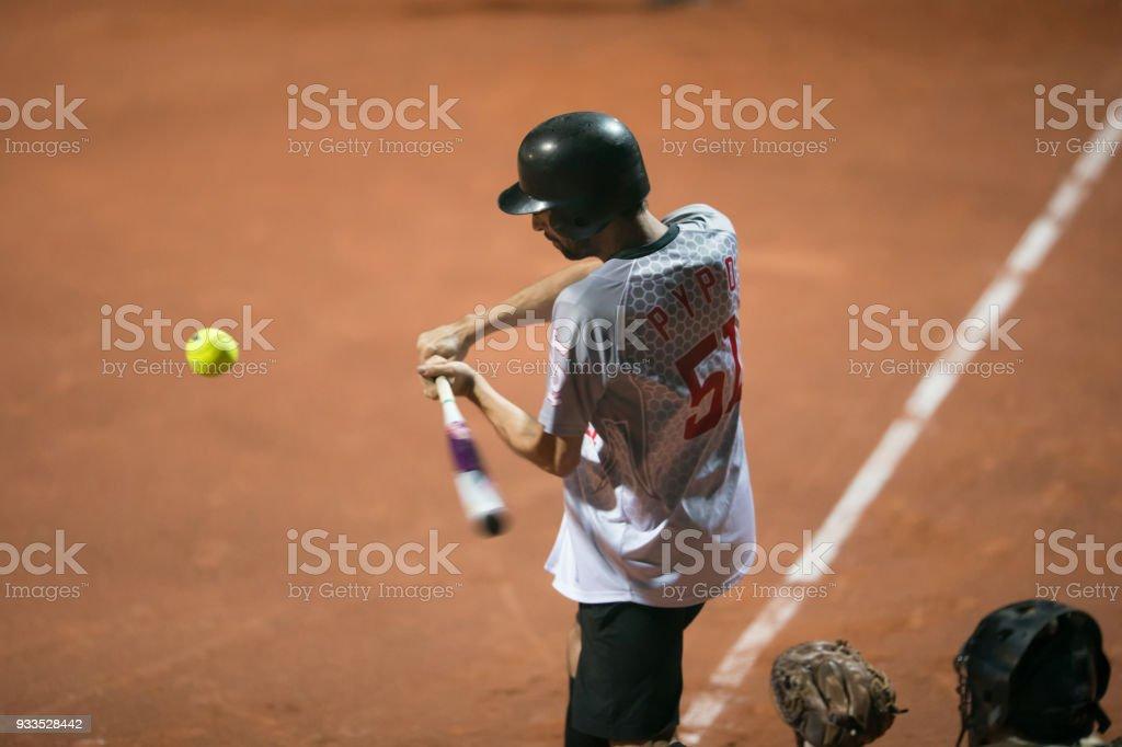 Softball Batter Swinging at the Ball Mid Air