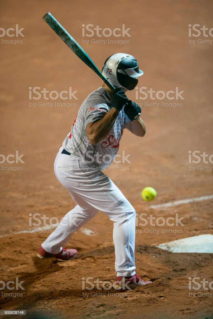 Softball Batter Trying to Hit the Ball