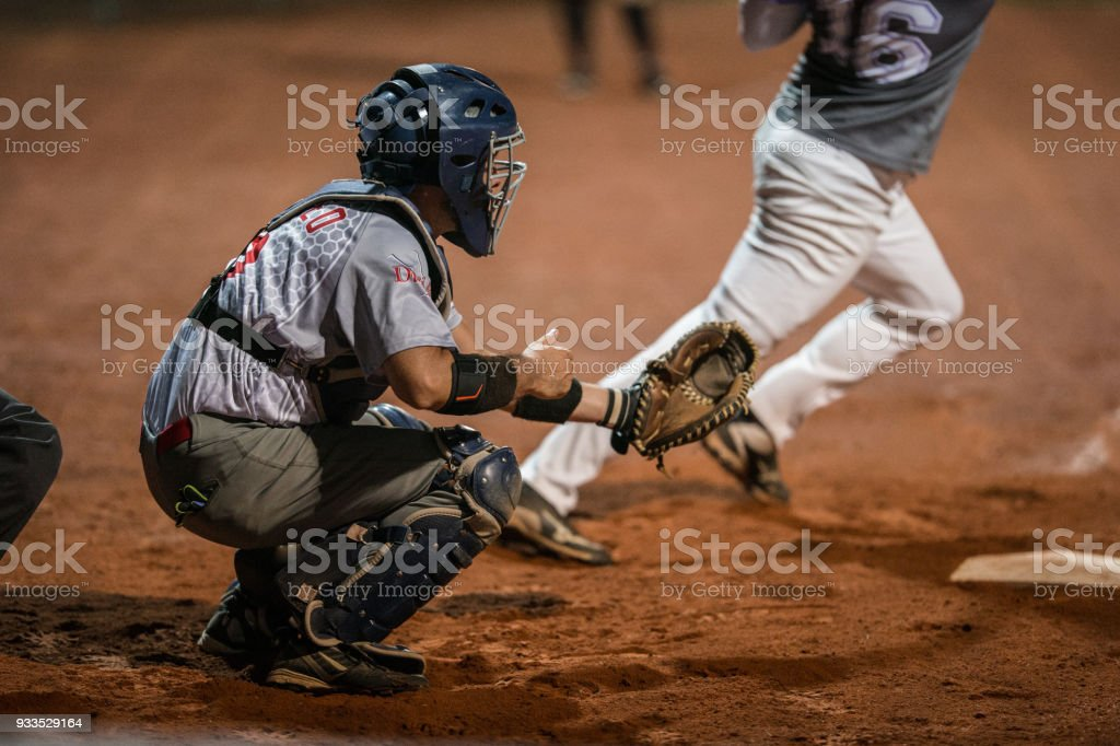 Softball Catcher Kneeling stock photo