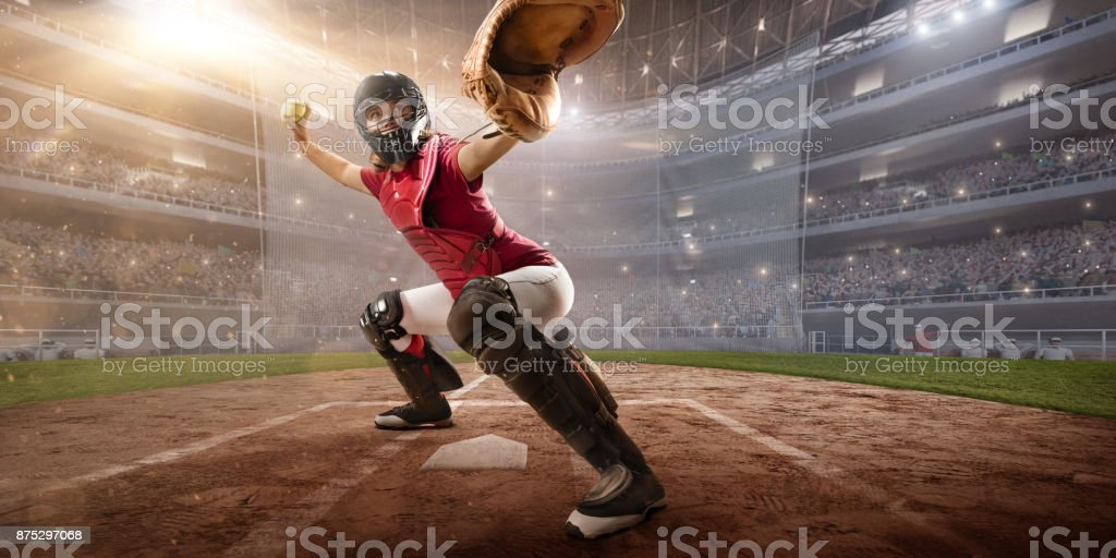 Softball female player on a professional arena. Beautiful athlete in...