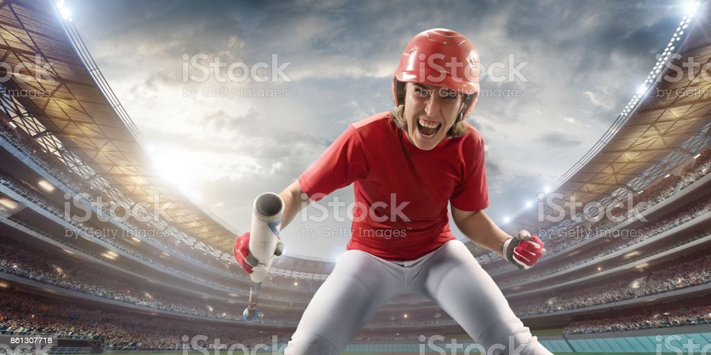 Softball female player happy after the victory on a professional arena stock photo