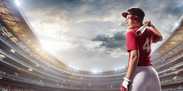 softball female player on a professional arena - softball stock photos and pictures