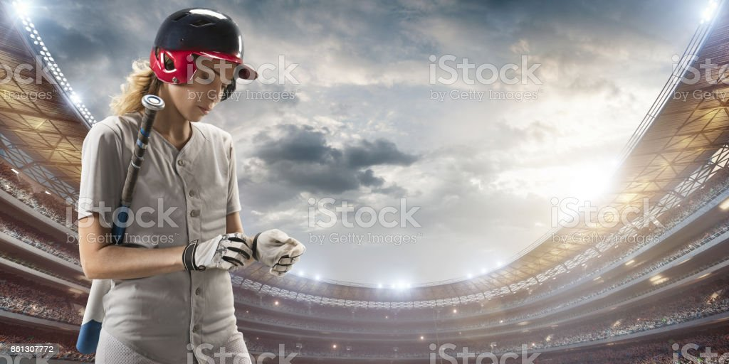 Softball female player on a professional arena stock photo