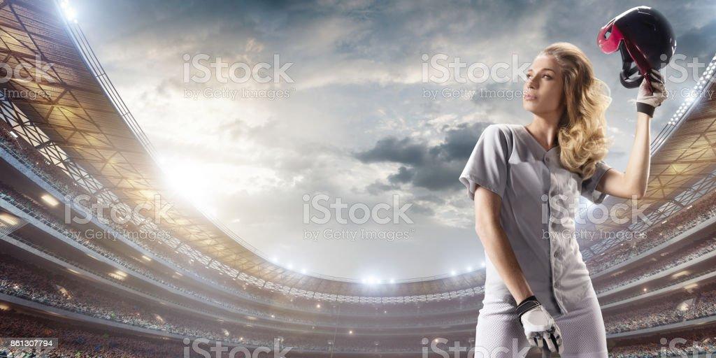 Softball female player on a professional arena. Beautiful athlete...