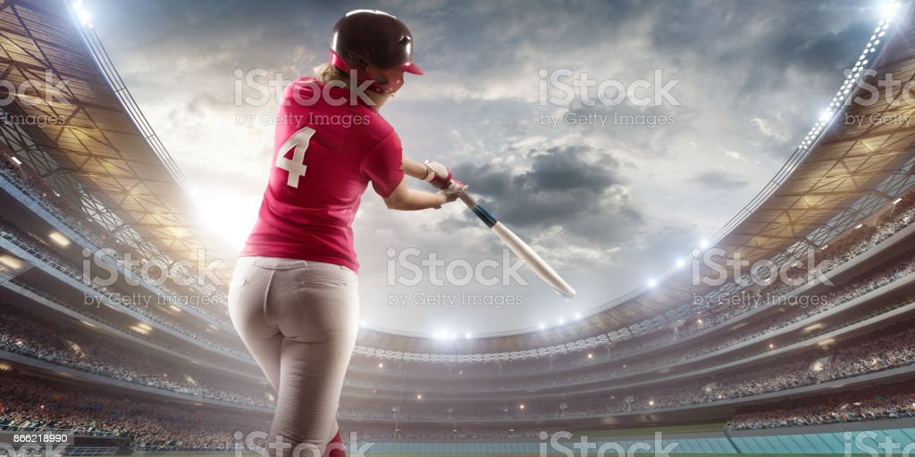 Softball female player on a professional arena. Beautiful athlete...