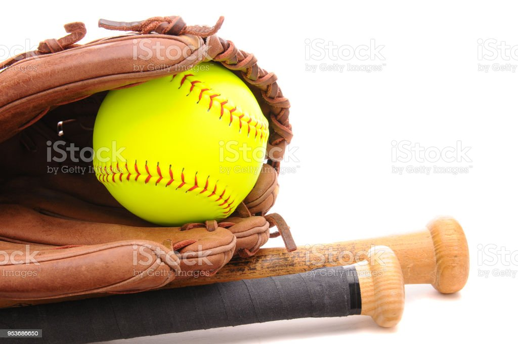 Softball Glove ball and two bats on white with copyspace stock photo