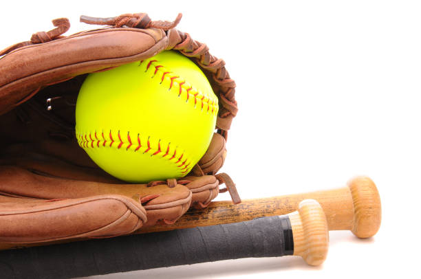 softball glove ball and two bats on white with copyspace - softball stock photos and pictures