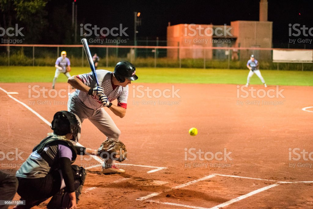 Softball Hitter and Catcher Waiting for Ball stock photo