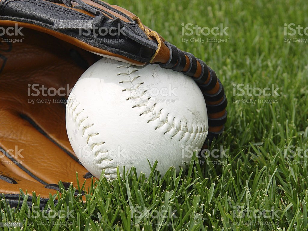 Softball in a glove stock photo