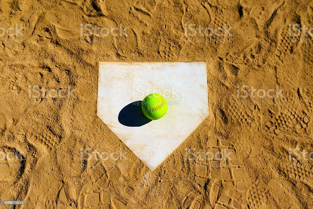 Softball in a softball field in California mountains on home plate