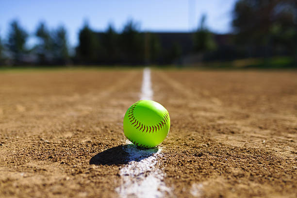 softball in a softball field in california mountains - softball stock photos and pictures