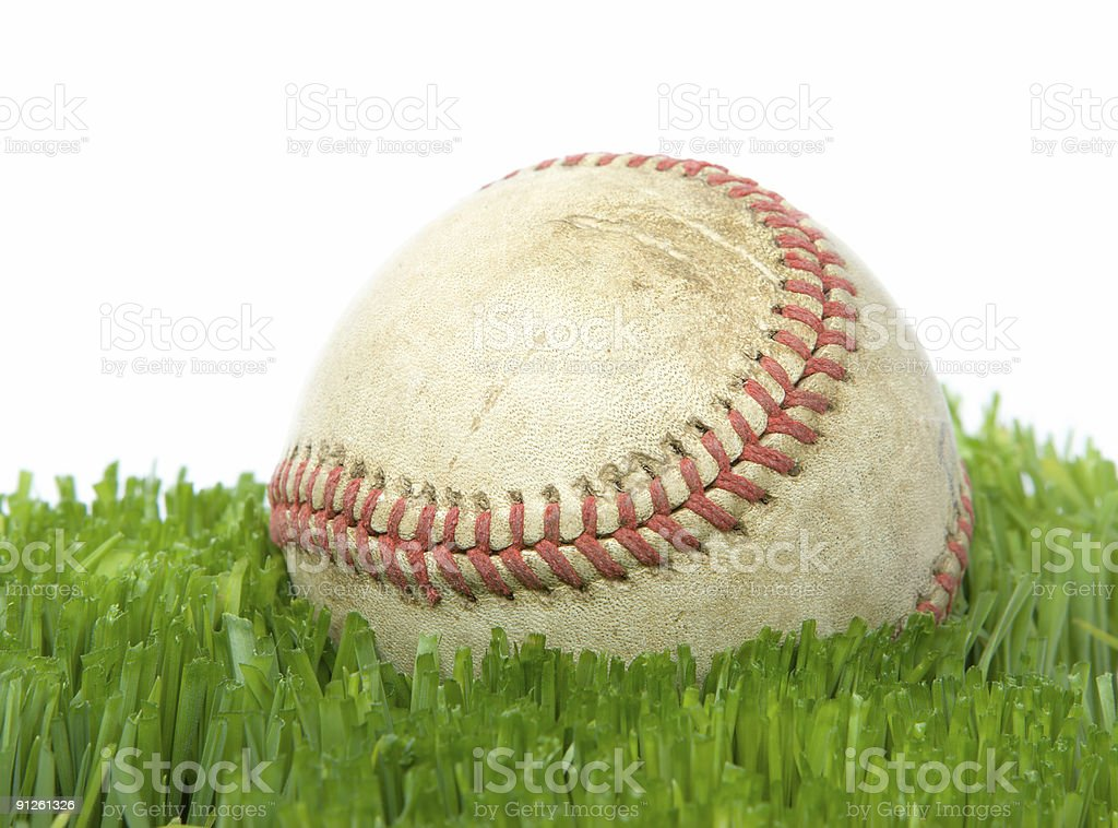 Softball in grass close up stock photo