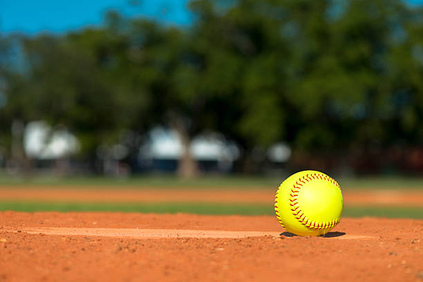 softball on baseball diamond - softball stock photos and pictures