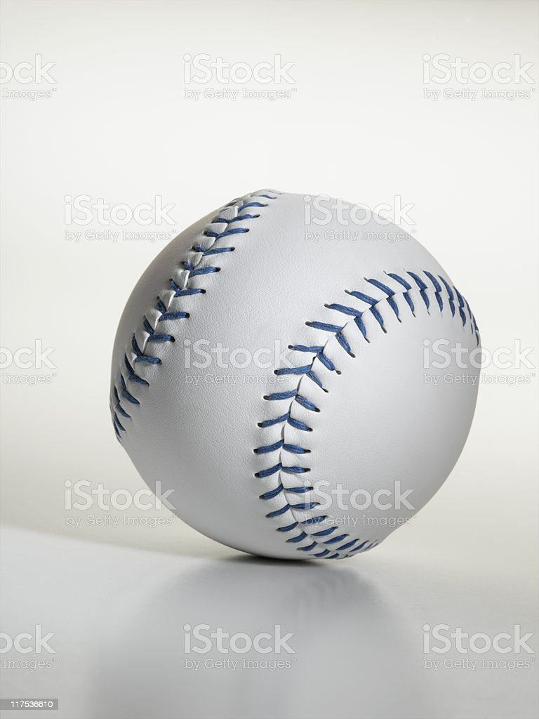 An official regulation slow pitch softball. A softball is larger in...