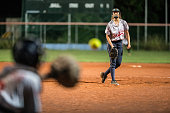 Female Softball Pitcher Looking at the Ball Mid Air